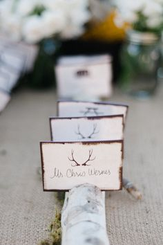 An escort card is a nearly blank canvas for the couple to share a bit about themselves. For a groom who loves to hunt, decorate male guests' assignments with an antler stamp. For female guests, opt for the bride's favorite flower or bird.  A small sign can be placed on the table to explain the meaning behind the details for guests who may be unaware of these facts.