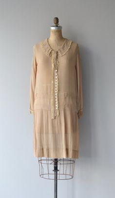 Antique 1920s latte silk dress with cream lace trim, a charming row of white buttons on a split panel collar, long sleeves, and pintucked drop waist.