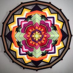 Sacred geometry and beautiful colors. Feels modern yet ancient.