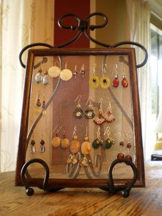 Earring Holder made with an old frame and mesh screen