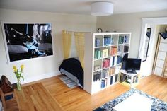 I like the shelf & curtain idea - could still do with a twin bed & frame, leaving space for nightstand, lamp, etc