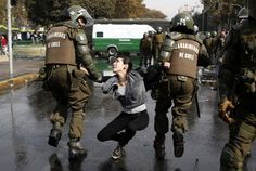 A demonstrator is detained during May Day rallies in Santiago, Chile. The first day of May was marked by protests around the world. Workers in Bangladesh demanded better working conditions in the wake May Days, Group Of Friends, Pictures Of The Week, Leaf Art, Animal Kingdom, Rally, Health And Wellness, Around The Worlds, 1970s