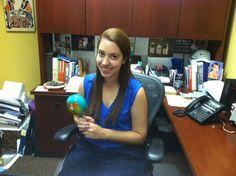 Nichole emulates Lisa while sitting at her desk!
