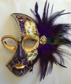 Venetian style Mardi Gras 3/4 face mask with purple and peacock feather and ribbon ties.