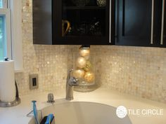 The Natural Varied Mother Of Pearl Backsplash By Tile Circle Really Pops With These Dark