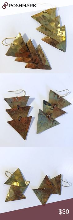 Never Worn Dangling Gold Triangle Earrings Pair of dangle earrings that feature three movable triangles.   Gold that purposefully has an almost rusted, aged coloring to it.  Lightly imprinted all over with circles.  Brand new, never worn, but no tags. Jewelry Earrings