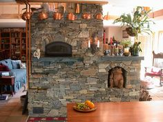 Back of masonry fireplace with place for bread oven on kitchen side.