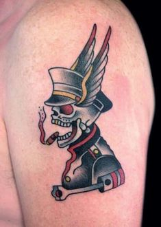 This tattoo features a smiling skeleton smoking a cigarette and wears a military uniform. The tattoo mostly consists of dark, grey colors, but it also includes some reds. The tattoo looks good on the shoulders, the arms and maybe even the legs. #tattoofriday #tattoos #tattooart #tattoodesign #tattooidea