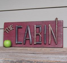 Rustic cabin sign. I would spell out WELCOME instead, but very cute idea!
