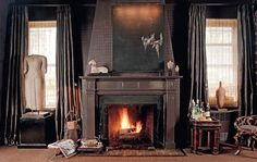 Manhattan living room by interior designer Susan Gutfreund. Gray painted surround is topped by embossed leather wall covering. Feels a bit like a haunted house to me.