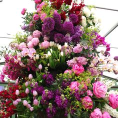 Tower of flowers at #RHSChelsea, talk about a stunning arrangement.