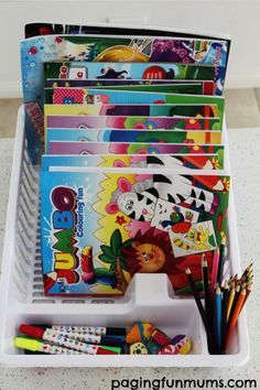 Stack all of your child's (or your own!) coloring books into a dish rack, so they're all easy to see and sort through. | 42 Money-Saving Dollar Store Tricks For Your Entire Life