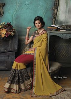Combination Of ochre yellow, red & black color chiffon based saree with broad border