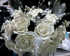 Bridal bouquet - pearls, crystals, feather, black poppy seed heads - by Daisy Crowe