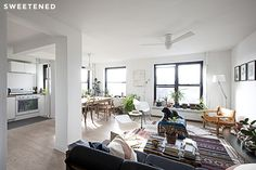 Sweeten.com Clinton Hill Co-op Renovation Such a great combination of simple white and colorful rugs and artwork.