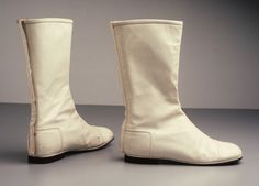 "Designed by André Courrèges. Collection, Powerhouse Museum (footwear). The similarities  that these boots has with the chair from the museum are the space theme, futuristic look, ""half moon"" shape, white color, and non-conventional style."