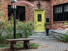 Curb Appeal Idea: Paint Your Front Door   Yellow Finch (2024-40), Benjamin Moore   Photographer: André Rider