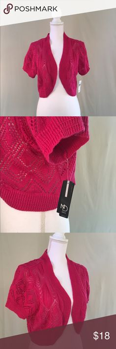 NWT Lacey Knit Crocheted Pink Shrug Made with beautiful open crochet work, this hot pink shrug from New Directions is the perfect layering piece. The delicate lace makes any outfit pop. The bright color makes it a fun piece to add to your spring and summer wardrobe.  Made from cotton blend. 50052 new directions Sweaters Shrugs & Ponchos