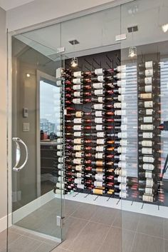 Vintage View Wine Racking - modern - wine cellar - vancouver - by Blue Grouse Wine Cellars (We like the glass with out the black outline -- almost more of a shower door look) Wine Cellar Modern, Modern Wine Rack, Glass Wine Cellar, Home Wine Cellars, Wine Cellar Design, Vintage View Wine Racks, Caves, Wine Cellar Basement, Wine Display