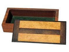 """Handmade box by J. Seaton with a lid of ebony, black palm, and lacewood. The body is made from cocobolo and is 1 1/2""""D. Each box is completely handmade using rare and exotic woods. Each is created spontaneously and no two are ever exactly alike. Each is sanded seven times to a satin smooth surface and finished in an oil and wax finish.  Size: 10""""L x 4 3/4""""W x 2 1/2""""H Price: $275.00  -- on ScrimshawGallery.com #woodworking #jewelrybox"""