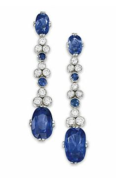 A PAIR OF SAPPHIRE AND DIAMOND EAR PENDANTS   Each oval mixed-cut sapphire top suspending a graduated series of millegrain-set circular-cut diamond triplets interspersed by single sapphire collets, to a larger oval mixed-cut sapphire drop