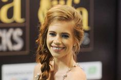 Bollywood actress Kalki Koechlin poses on the green carpet for the International Indian Film Academy (IIFA) awards 'Rocks' event, in Singapore on June 8, 2012.