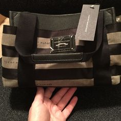 Tommy Hilfiger Hand Bag NWT NWT handbag. Snap top closure and side snap storage. Zipper inside pocket. Very cute. Tommy Hilfiger Bags Mini Bags