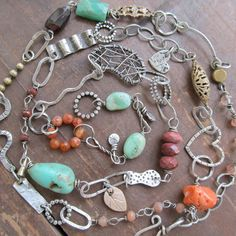 Long Funky Sterling Necklace Gemstone charms Turquoise Orange wire wrapped. $310.00, via Etsy.