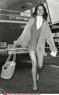 A black and white photo shows Rampling trailblazing the trends of 1968 but via her own relaxed take. Note the ballet shoes on her feet