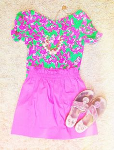 Lilly pink and green top with a bright pink skirt and pink Jack Rodger sandals.