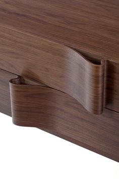 Studio Arthur Casas: Top Brazilian architect Arthur Casas' Onda sideboard detail is simply wow!    The wavy front of the drawers' handle is made by pressing various thin layers of wood in a surprising way. The sideboard can be hung on the wall or stand on feet. #Details #Interior