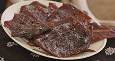 The Only Venison Jerky Recipe You'll Ever Need. While some cuisine-crazed folks would just as well add exotic ingredients, this homemade venison jerky recipe is Smoker Jerky Recipes, Venison Jerky Recipe, Jerkey Recipes, Jerky Marinade, Venison Recipes, Venison Meat, Hot Deer Jerky Recipe, Peppered Beef Jerky Recipe, Barbecue