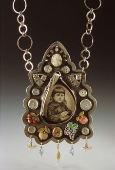 "Necklace | Kristin Diener.  ""Memento Mori. 2005 "".  Sterling silver, fine silver, gold, eyeglass frame and lens, 1887 print of boy, shell buttons, found objects mica, metal foil"