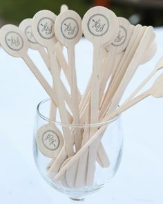 Monogrammed swizzle sticks for cocktail hour