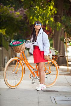 Marthu Bisso bikes in style in a Maison Martin Margiela sweater and top, Zara skirt, Kate Spade purse, and Reebok shoes.