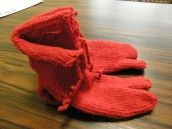 """Replica of socks dating to Roman Egypt, circa 250-420 AD: """"The big toe divided from the others suggest that the socks were probably meant to be worn with sandals. It is unclear whether the socks formed offerings to the dead or were used as foot coverings. Note that the holes have not laddered (though they have spread somewhat)."""" Made in Poland."""