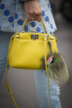 From Louis Vuitton's top-handled trunks to Chanel's slouchy new Girl, the It bag remains the ultimate street style bait