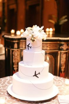 airplane wedding cake--- minus the flowers on top? Tie in with silver or purple instead of black?