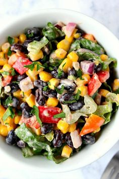 Black Bean Taco Salad Recipe Black Bean Taco Salad Recipe - lighter version of the classic taco salad. Packed with vegetables and black beans in place of chicken for protein. The dressing is simply irresistible! Black Bean Taco Salad Recipe, Black Bean Recipes, Taco Salad Recipes, Salad Recipes For Dinner, Healthy Salad Recipes, Mexican Food Recipes, Vegetarian Recipes, Cooking Recipes, Cooking Tips