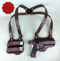 Our 1911 Shoulder holster is available in several color options and styles. The shoulder holster pictured is Dark Brown and designed for a right hand draw (carried on the left) with two magazines at the ready on the right. The Shoulder holster is completely adjustable to fit anyones size and needs. Also included, but not pictured are two adjustable belt straps which secure with a snap, they are removable for personal preferences.  This Shoulder Holster is available in three models. One…