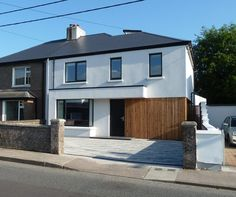Loïc DEHAYE ARCHITECTS designed this contemporary timber frame extension and full refurbishment of a semi-detached house on the Ballinlough Road in Cork Council House Makeover, Council House Renovation, House Cladding, Exterior Cladding, Facade House, House Extension Plans, House Extension Design, 1930s Semi Detached House, White Exterior Houses