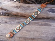 Like this one. Check out black one on the site. Beaded loomed wrap bracelet with by UnderWrapsBoutique on Etsy, $55.00