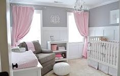 White beadboard, cherry furniture, grey walls, pink accents.