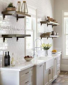Wood and brass kitchen shelves