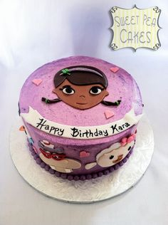Doc McStuffins Birthday Cake - Here's a small Doc McStuffins smash cake that accompanied a dozen St. Patrick's day cupcakes.