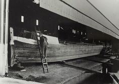 "Caption "" Grand Union Canal Carrying Company narrowboat being painted""  BW192-3-1-13-4 #London #canal #Boat"