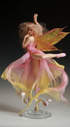 "Tinkerbell's Dance is a one of a kind polymer art sculpture by artist Nicole West. Each piece is sculpted entirely by hand by the artist so it is the only one of its kind in the entire world.  She is equivalent to 9"" high sculpt. This ethereal lady is sculpted with every detail including fingernails, teeth and fine hair eyelashes.   She has beautiful Tibetan Lamb hair in pale strawberry blonde.   Her eyes are handmade by the artist."