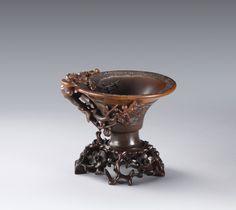 A rare circular rhinoceros horn 'Prunus' libation cup, Qing Dynasty, 17th-18th century