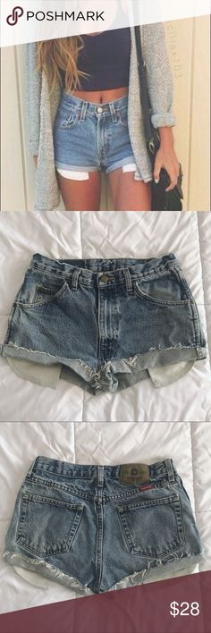 "Adorable High Waisted wrangler denim shorts Adorable vintage wrangler shorts. Similar to brandy melville and john galt shorts. Vintage. Perfect for summer! High waisted with a cuffed edge and a perfect light blue wash. Cute pockets peeking out. Waist measures as 29 inches  Measurements Waist: 14.5"" Hips: 20"" Rise: 11""  ⭐️ Top-rated seller!  All items ship same or next day  Free stickers with purchase   All reasonable offers considered!   15% discount on Bundles!   Feel free to ask questions…"