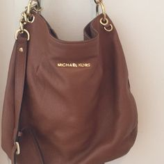 Brown Michael Kors bag Authentic Michael Kors bag. Bought from another posher but the brown wasn't what I was looking for. Some imperfections from normal wear and tear but still an impeccable bag from a talented designer. Michael Kors Bags